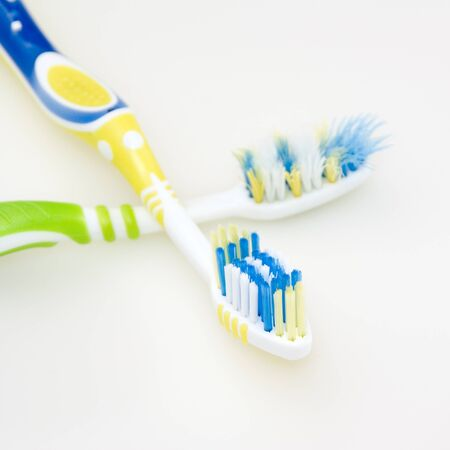 Toothbrushes used and new