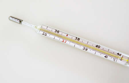 The glass thermometer isolated Stock Photo - 15600372