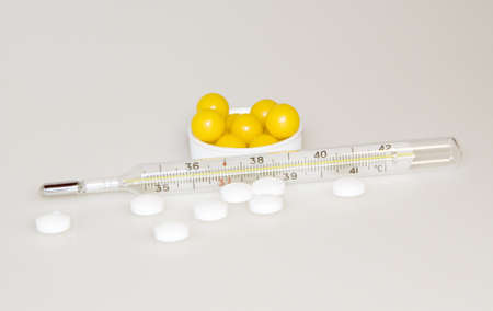 The thermometer, pills and vitamins  photo
