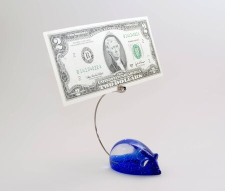 Note-paper holder with dollar Stock Photo