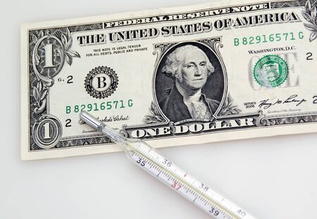 One dollar banknote and thermometer