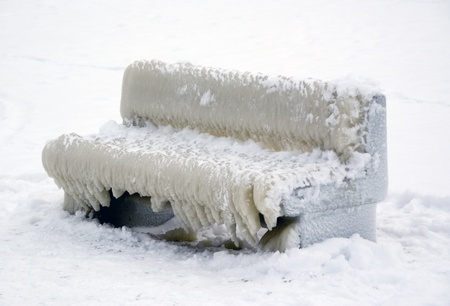 Bench covered with ice  Stock Photo