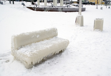 Bench covered with thick coat of ice