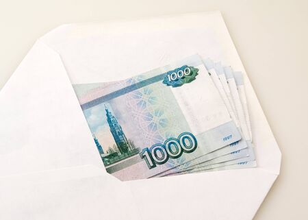White clear envelope with money