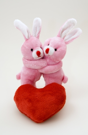 express feelings: Red plush heart and two bunny