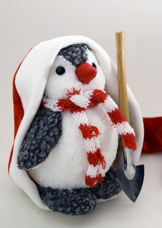 s eve: Penguin in cap with shovel Stock Photo