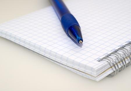 recap: Blue pen and notebook close up