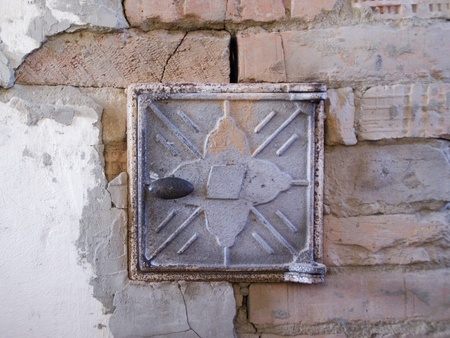 Flap of rustic stove from brick