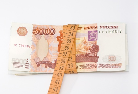 The stack of money and measuring tape Stock Photo