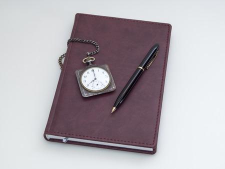 Retro pocket watch, diary and pen