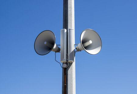 Street speakers in blue sky