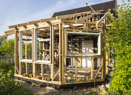 Wooden house under construction Stock Photo