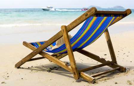 Lounge on the sandy beach of tropical sea Stock Photo