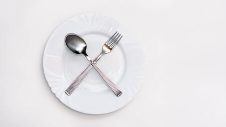 Fork, spoon and white plate