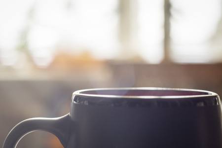 Morning hot cup of coffee with smoke