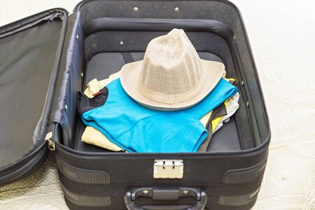 lothes for vacation in suitcase