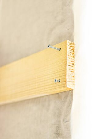 fastened: Wood board must be fastened with screws