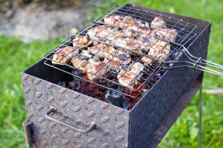 brazier: Meat on skewer frying on brazier Stock Photo