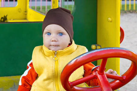 one year old: One year old boy at the wheel
