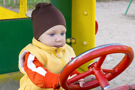 one year: One year boy in toy car Stock Photo