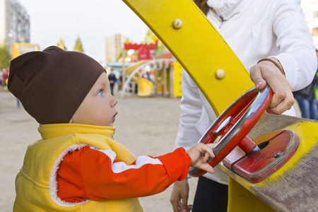 one year: One year small boy in toy car