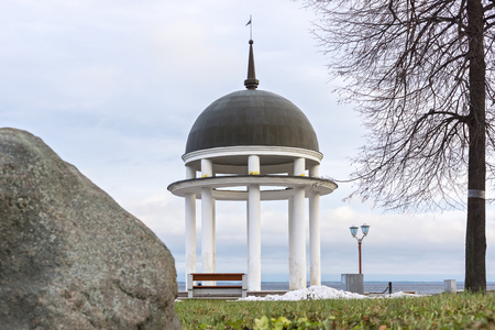 Rotunda on shore of lake in winter