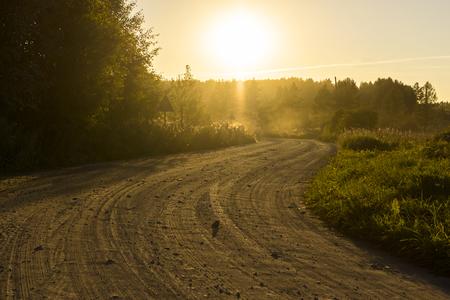 Rural dirt road at sunset