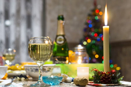 festal: Christmas table, Christmas tree and champagne