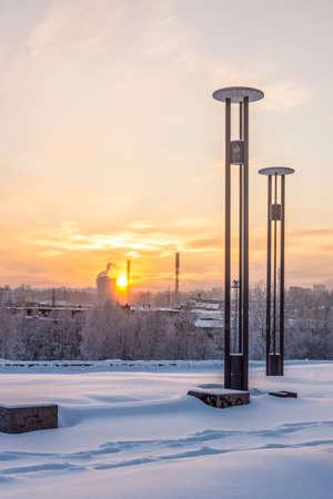 Winter cityscape on sunset