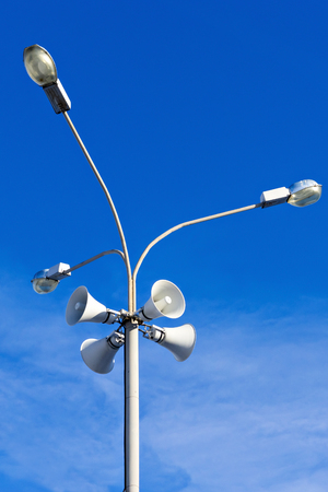 declare: Four outdoor megaphones on street light