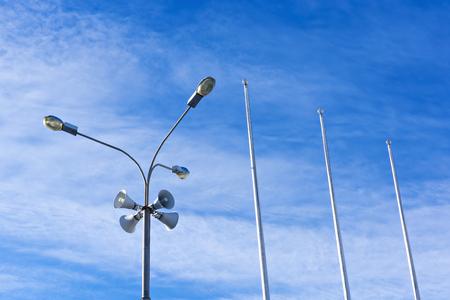 pronounce: Four outdoor megaphones on one street light