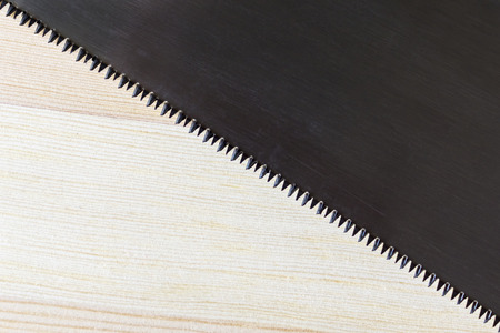 Hacksaw blade and wood plank texture