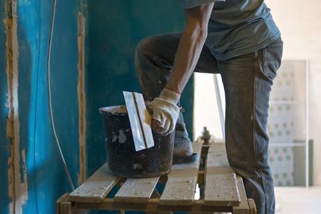repairs: Builder makes repairs of walls