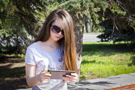 enjoys: Long haired girl enjoys the tablet