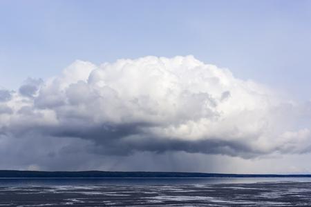 formidable: Formidable cloud over lake Stock Photo