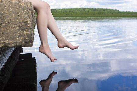 dangling: Legs dangling over water