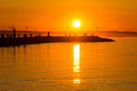Hot orange sundown on lake