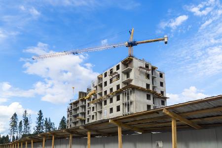 Construction of modern skyscraper with crane Stock Photo