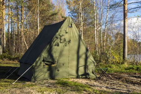 Oldschool camp tent in forest