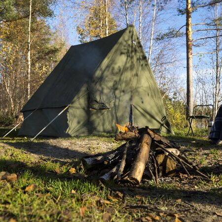 oldschool: Retro tent in forest and camp fire