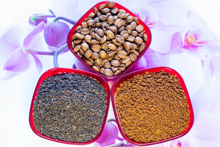 Tea leaves, coffee beans and instant coffee