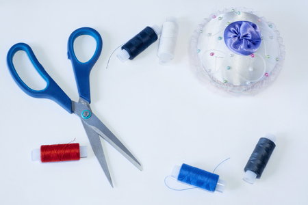 darn: Tailoring tools are scissors needle and threads