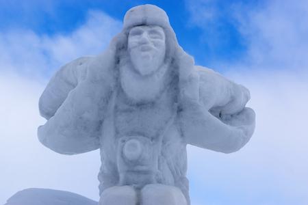 dashing: Snow sculpture of dashing photographer