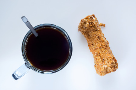 Coffee and eclair, top view Stock Photo