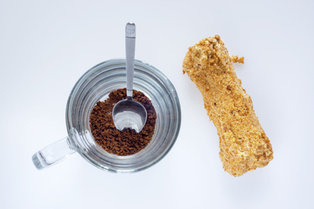 Instant coffee and eclair, top view