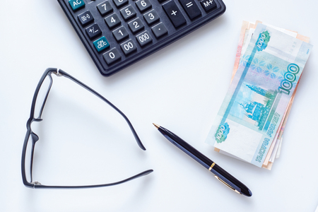 Business concept: glasses, pen, calculator and money