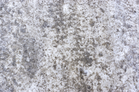 Dirty background of ground with snow in winter Stock Photo