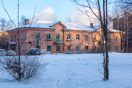 Old two-storey house in winter Stock Photo