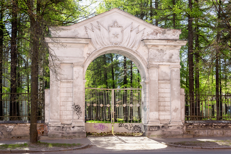 Old gate arch of military unit of Soviet Army Stock Photo