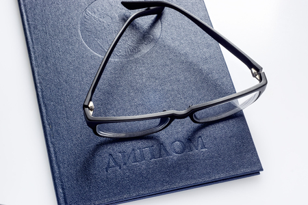 Glasses on diploma of higher education